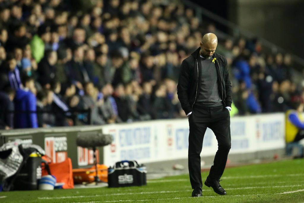 WIGAN, ENGLAND - FEBRUARY 19: A dejected Pep Guardiola the head coach / manager of Manchester City during The Emirates FA Cup Fifth Round match between Wigan Athletic and Manchester City at DW Stadium on February 19, 2018 in Wigan, England. (Photo by Robbie Jay Barratt - AMA/Getty Images)