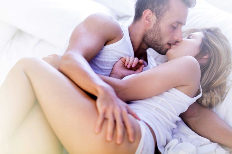 Picture of attractive man and woman kissing with passion