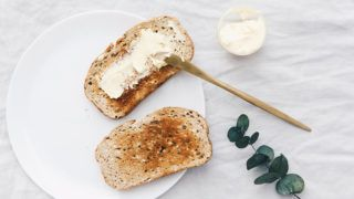 Flat lay rustic background with Slices of toast Fresh rye bread and butter