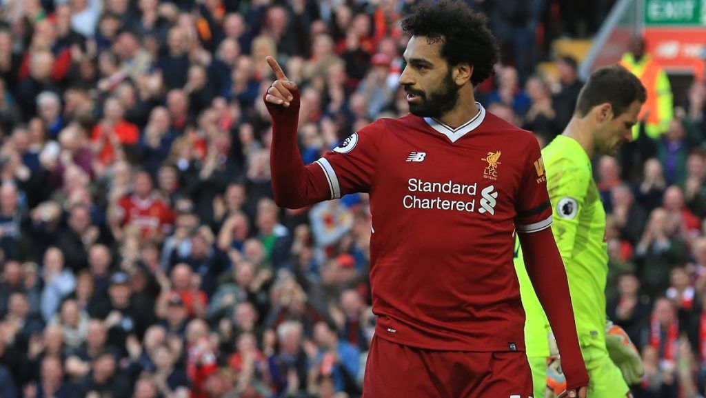 Liverpool's Egyptian midfielder Mohamed Salah celebrates after scoring their second goal during the English Premier League football match between Liverpool and Bournemouth at Anfield in Liverpool, north west England on April 14, 2018. / AFP PHOTO / Lindsey PARNABY / RESTRICTED TO EDITORIAL USE. No use with unauthorized audio, video, data, fixture lists, club/league logos or 'live' services. Online in-match use limited to 75 images, no video emulation. No use in betting, games or single club/league/player publications.  /