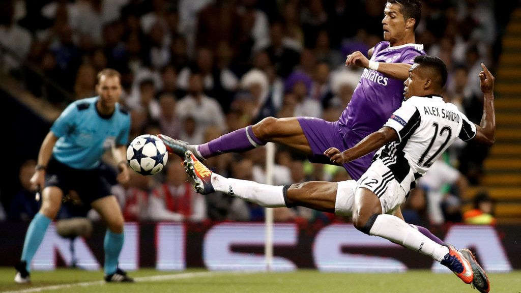 CARDIFF, WALES - JUNE 3: Cristiano Ronaldo of Real Madrid in action against Alex Sandro (R) of Juventus during UEFA Champions League Final soccer match between Juventus and Real Madrid at Millennium Stadium in Cardiff, Wales on June 3, 2017. Burak Akbulut / Anadolu Agency
