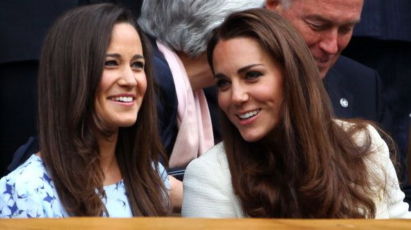 LONDON, ENGLAND - JULY 08:  Pippa Middleton (L) and Catherine, Duchess of Cambridge sit in the Royal Box during the Gentlemen's Singles final match between Roger Federer of Switzerland and Andy Murray of Great Britain on day thirteen of the Wimbledon Lawn Tennis Championships at the All England Lawn Tennis and Croquet Club on July 8, 2012 in London, England.  (Photo by Clive Brunskill/Getty Images)