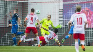 Hoffenheim's Czech defender Pavel Kaderabek (L) scores the third goal past Leipzig's Hungarian goalkeeper Peter Gulacsi (C) during the German first division Bundesliga football match between RB Leipzig and TSG Hoffenheim in Leipzig, eastern Germany on April 21, 2018.  / AFP PHOTO / ROBERT MICHAEL / RESTRICTIONS: DURING MATCH TIME: DFL RULES TO LIMIT THE ONLINE USAGE TO 15 PICTURES PER MATCH AND FORBID IMAGE SEQUENCES TO SIMULATE VIDEO. == RESTRICTED TO EDITORIAL USE == FOR FURTHER QUERIES PLEASE CONTACT DFL DIRECTLY AT + 49 69 650050  / RESTRICTIONS: DURING MATCH TIME: DFL RULES TO LIMIT THE ONLINE USAGE TO 15 PICTURES PER MATCH AND FORBID IMAGE SEQUENCES TO SIMULATE VIDEO. == RESTRICTED TO EDITORIAL USE == FOR FURTHER QUERIES PLEASE CONTACT DFL DIRECTLY AT + 49 69 650050