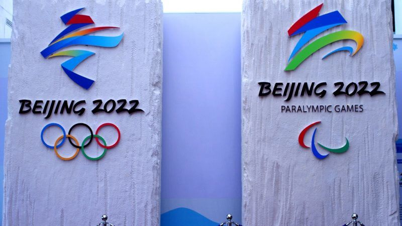 """View of the official emblems of the Beijing 2022 Olympic and Paralympic Winter Games on display at the Beijing National Aquatics Center, also known as the Water Cube, in Beijing, China, 15 January 2018.  Beijing, which hosted the Olympics in 2008, will become the first city ever to hold both the summer and winter Games as the country looks to burnish its sporting prestige. In the Olympics logo: bold brushstrokes of colour resembling the shape of a skier as well as the Chinese character for """"winter""""."""