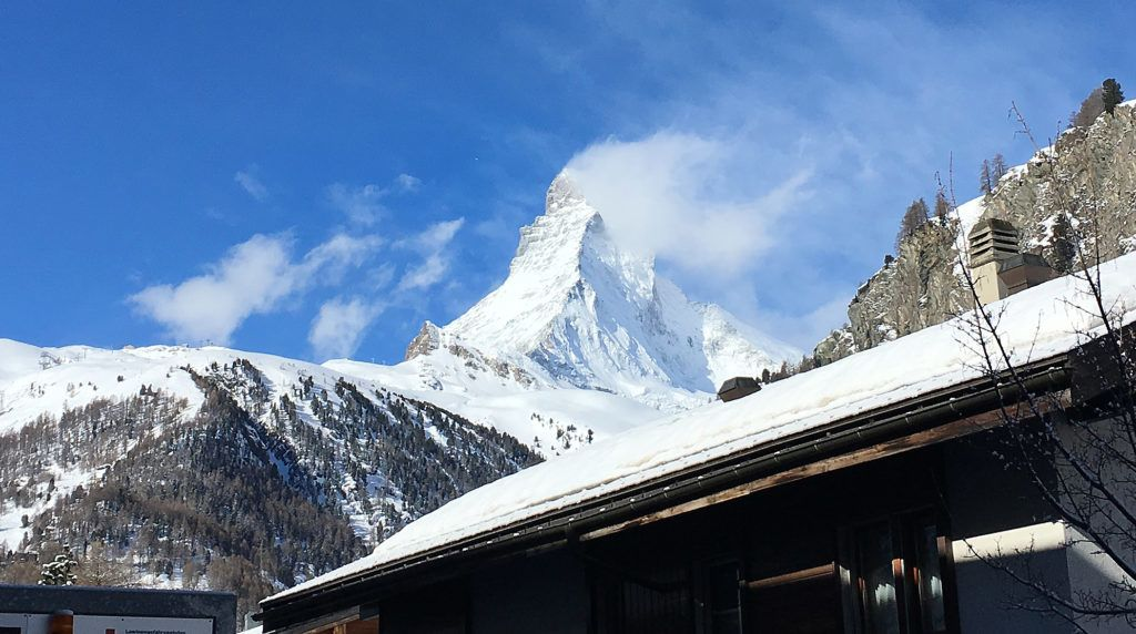 dpatop - 12 April 2018, Switzerland, Zermatt: The Matterhorn mountain looms over the popular tourist town of Zermatt. The search for missing German Karl-Erivan Haub, CEO of the Tengelmann Group, is complicated by adverse weather conditions. Rescue teams are struggling with strong winds. Photo: Christiane Oelrich/dpa