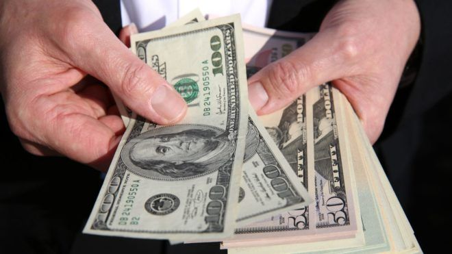 Businessman with US Dollars