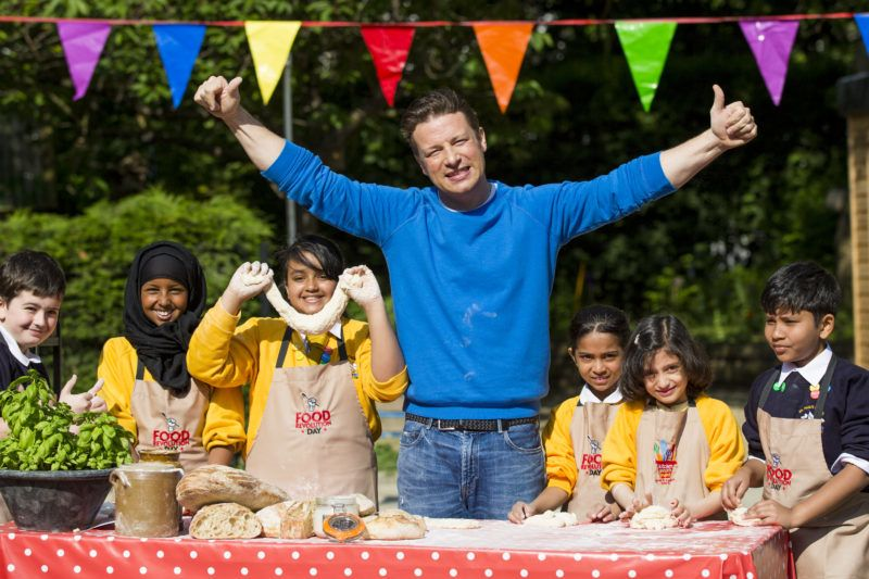 LONDON, ENGLAND - MAY 16:  Jamie Oliver joins children from St Paul's Whitechapel CE Primary school to celebrate the third annual Food Revolution Day on May 16, 2014 in London, England.  (Photo by Tristan Fewings/Getty Images)