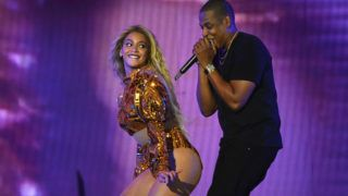 """EAST RUTHERFORD, NJ - OCTOBER 07:  Entertainer Beyonce and Jay Z perform on stage during closing night of """"The Formation World Tour"""" at MetLife Stadium on October 7, 2016 in East Rutherford, New Jersey.  (Photo by Larry Busacca/PW/WireImage)"""