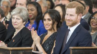 LONDON, ENGLAND - APRIL 23: Prime Minister Theresa May (L), Prince Harry (R) and Meghan Markle (C) attend a memorial service at St Martin-in-the-Fields in Trafalgar Square to commemorate the 25th anniversary of the murder of Stephen Lawrence on April 23, 2018 in London, England.. The 18-year-old murder victim was fatally stabbed by a gang of racists in Eltham, south-east London, on April 22 1993. (Photo by David Parker-WPA Pool/Getty Images)