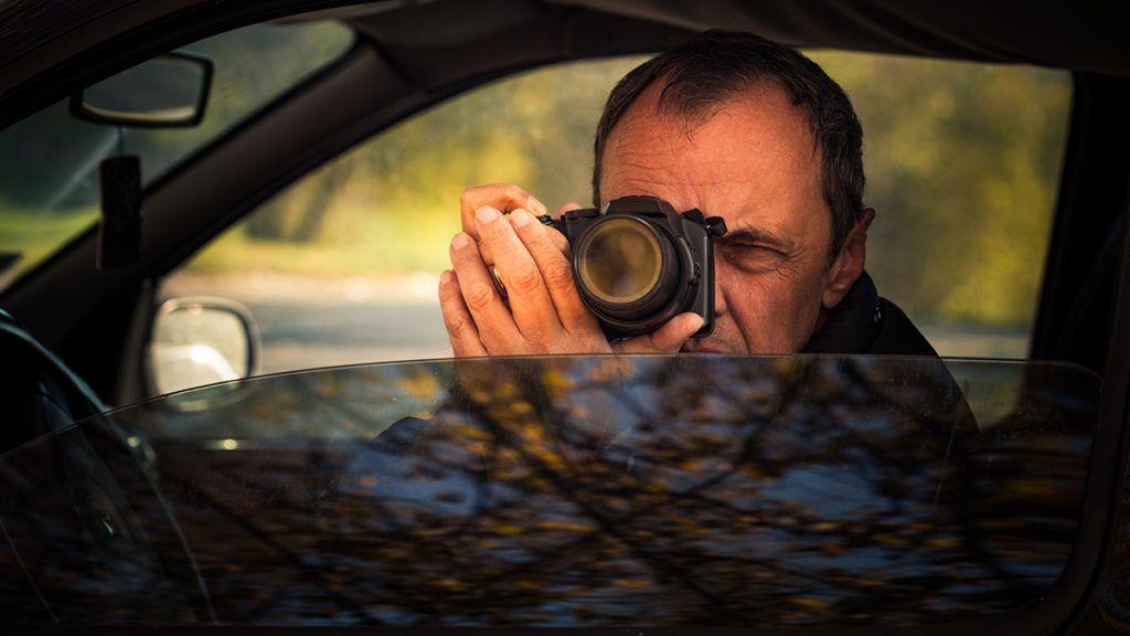undercover man detective hidden in car secretly take photoundercover man detective hidden in car secretly take photo