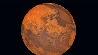 Planet Mars isolated in black