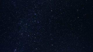 Dark night sky with plenty of stars as background