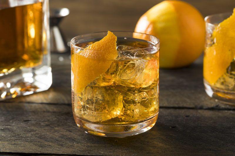 Boozy Homemade Old Fashioned Bourbon on the Rocks with an Orange Garnish