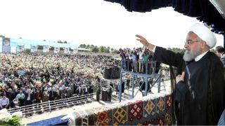 """A handout picture provided by the Iranian presidency on May 6, 2018 shows President Hassan Rouhani giving addressing crowds during a rally in the northwestern city of Sabzevar.Rouhani said on May 6 that if the United States quits the nuclear deal between Tehran and world powers then Washington would regret it """"like never before"""". / AFP PHOTO / Iranian Presidency / - / === RESTRICTED TO EDITORIAL USE - MANDATORY CREDIT """"AFP PHOTO / HO / IRANIAN PRESIDENCY"""" - NO MARKETING NO ADVERTISING CAMPAIGNS - DISTRIBUTED AS A SERVICE TO CLIENTS ==="""