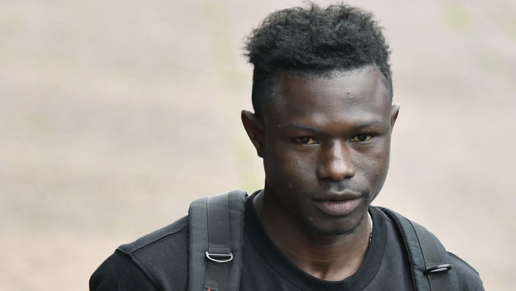 """Malian migrant Mamoudou Gassama arrives to receive his temporary residence permit at the Prefecture of Bobigny, northeast of Paris on May 29, 2018, one day after he was honored by the French President for scaling an apartment building to save a 4-year-old child dangling from a fourth-floor balcony.  Two days after his daring rescue -- viewed millions of times online -- Mamoudou Gassama, 22-year old,  nicknamed """"Spiderman"""" by French media for his astonishing climbing ability and feted as a hero, was offered by French President citizenship, and a job with the fire service.  / AFP PHOTO / GERARD JULIEN / ALTERNATIVE CROP"""