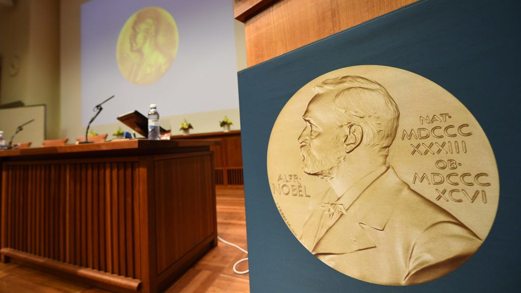 A medal of Alfred Nobel is pictured prior to the beginning of a press conference to announce the winner of the 2017 Nobel Prize in Medicine on October 2, 2017 at the Karolinska Institute in Stockholm.The 2017 Nobel prize season kicks off with the announcement of the medicine prize, to be followed over the next days by the other science awards and those for peace and literature. / AFP PHOTO / Jonathan NACKSTRAND