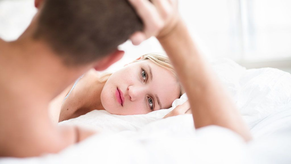 Couple in bed. Paris, France VOISIN/PHANIE