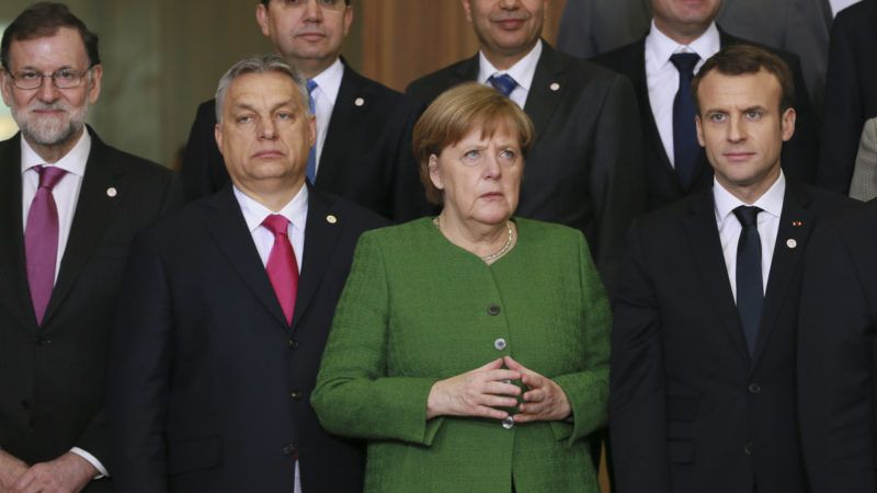 (FromL) Spanish Prime Minister Mariano Rajoy, Hungarian Prime Minister Viktor Orban, German Chancellor Angela Merkel and French President Emmanuel Macron pose for a family photo during a High Level Conference on the Sahel at the European Commission in Brussels on February 23, 2018. / AFP PHOTO / POOL / OLIVIER HOSLET
