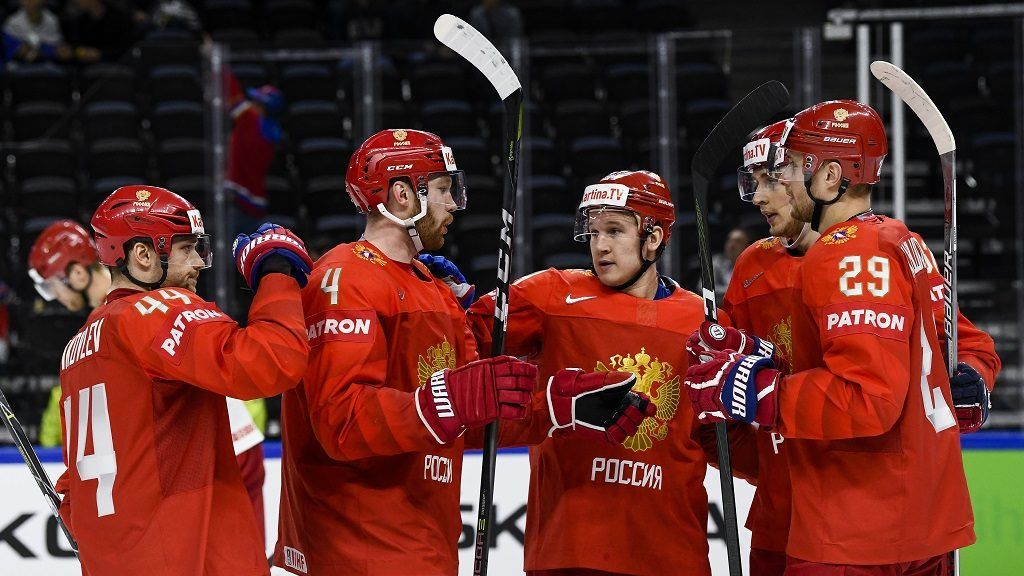 Russia's Maxim Shalunov (2ndR) celebrates with his teammates after scoring a goal during the group A match Belarus vs Russia of the 2018 IIHF Ice Hockey World Championship at the Royal Arena in Copenhagen, Denmark, on May 7, 2018. / AFP PHOTO / Jonathan NACKSTRAND