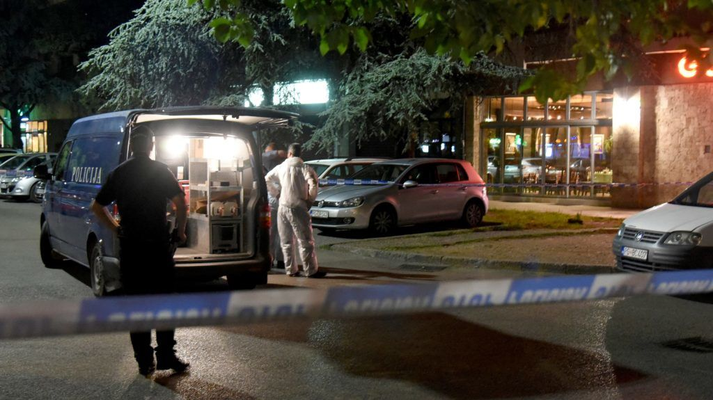 """Police officers secure a crime scene after an attacker shot an investigative reporter in Montenegro's capital Podgorica on May 8, 2018.   An attacker shot an investigative reporter in Montenegro Tuesday, police said, prompting calls from the European Union and the United States to protect journalists in the Balkan country. Olivera Lakic """"has a bullet wound in her right leg but her life is not in danger,"""" the police chief Vesko Damjanovic told reporters. / AFP PHOTO / SAVO PRELEVIC"""