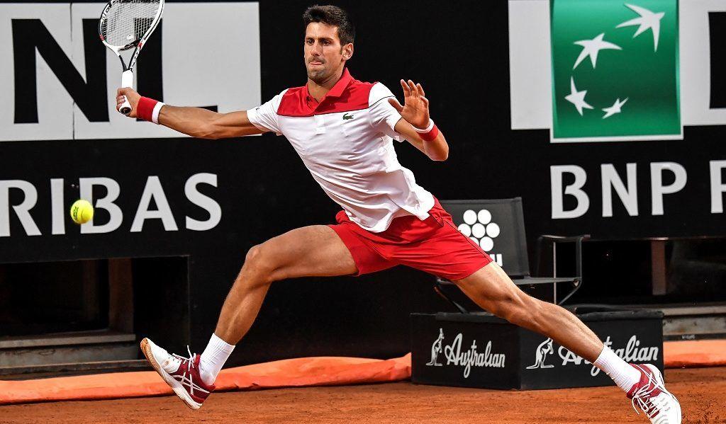 Serbia's Novak Djokovic returns the ball to Spain's Albert Ramos Vinolas during the ATP Tennis Open tournament on May 17, 2018 at the Foro Italico in Rome.  / AFP PHOTO / Andreas SOLARO