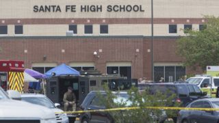 """Emergency crews gather in the parking lot of Santa Fe High School where at least eight people were killed on May 18, 2018 in Santa Fe, Texas.  At least eight people were killed when a student opened fire at his Texas high school on May 18, 2018, as President Donald Trump expressed """"heartbreak"""" over the latest deadly school shooting in the United States. The shooting took place as classes were beginning for the day at Santa Fe High School in the city of the same name, located about 30 miles (50 kilometers) southeast of Houston.""""There are multiple fatalities,"""" Harris County Sheriff Ed Gonzalez told reporters. """"There could be anywhere between eight to 10, the majority being students.""""      / AFP PHOTO / Daniel KRAMER"""