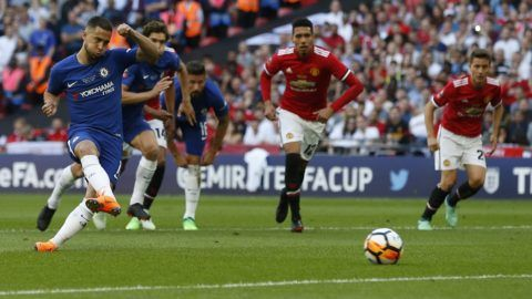 Chelsea's Belgian midfielder Eden Hazard (L) shoots and scores from the penalty spot during the English FA Cup final football match between Chelsea and Manchester United at Wembley stadium in London on May 19, 2018. / AFP PHOTO / Ian KINGTON / NOT FOR MARKETING OR ADVERTISING USE / RESTRICTED TO EDITORIAL USE