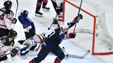 United States' Anders Lee (C) celebrates after scoring a goal during the bronze medal match USA vs Canada of the 2018 IIHF Ice Hockey World Championship at the Royal Arena in Copenhagen, Denmark, on May 20, 2018. / AFP PHOTO / JOE KLAMAR