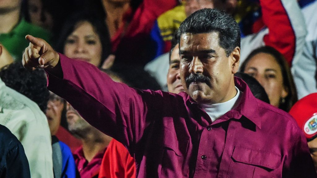 Venezuelan President Nicolas Maduro gestures after the National Electoral Council (CNE) announced the results of the voting on election day in Venezuela, on May 20, 2018. President Nicolas Maduro was declared winner of Venezuela's election Sunday in a poll rejected as invalid by his rivals, who called for fresh elections to be held later this year. With more than 90 percent of the votes counted,  Maduro had 67.7 percent of the vote, with his main rival Henri Falcon taking 21.2 percent, the National Election Council chief Tibisay Lucena announced. / AFP PHOTO / Juan BARRETO