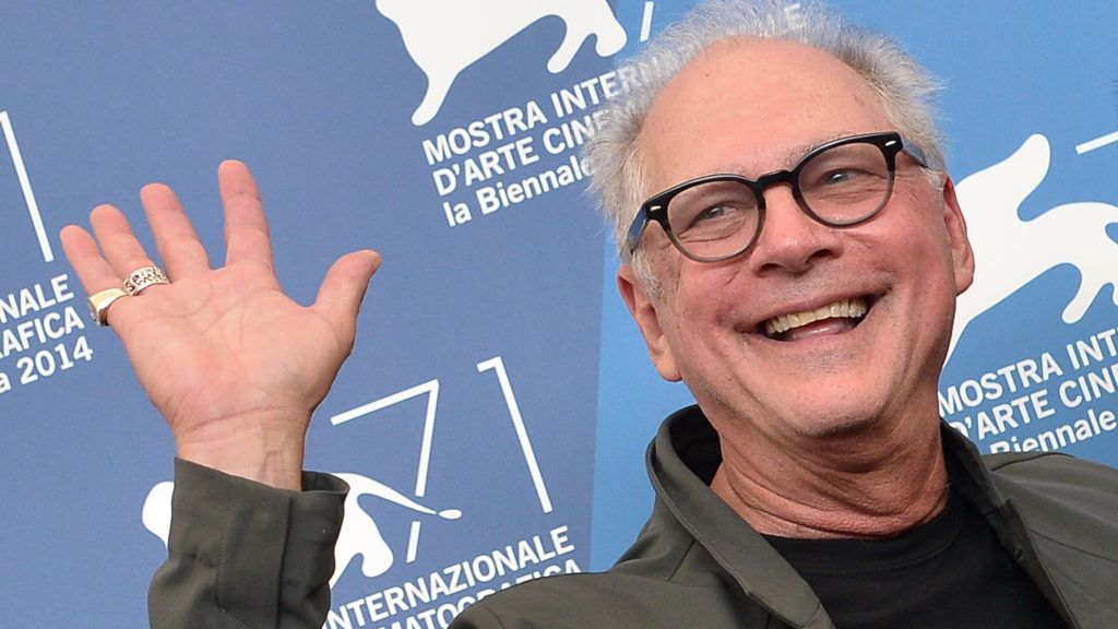"""(FILES) In this file photo taken on August 30, 2014 US director Barry Levinson poses during the photocall of the movie """"The Humbling"""" presented out of competition at the 71st Venice Film Festival at Venice Lido.   """"Rain Man"""" director Barry Levinson will get the top prize at the Czech Republic's Karlovy Vary film festival in July, the organisers said on May 23, 2018. / AFP PHOTO / Tiziana FABI"""