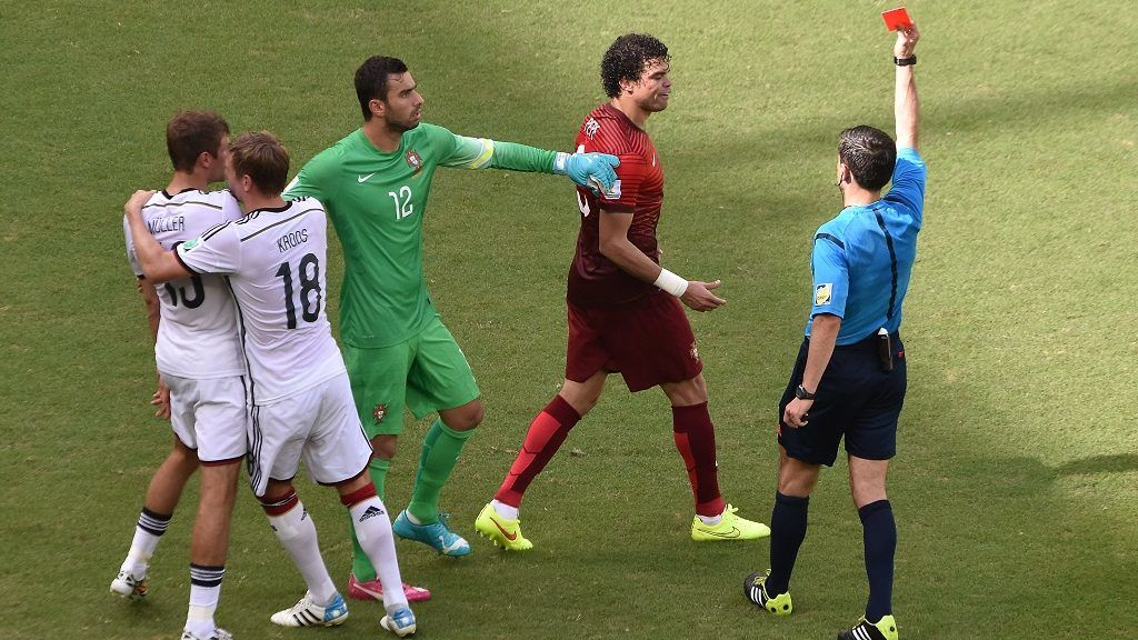 Portugal's defender Pepe (2nd R) receives the red card from Serbian referee Milorad Mazic (R) during the Group G football match between Germany and Portugal at the Fonte Nova Arena in Salvador during the 2014 FIFA World Cup on June 16, 2014.  AFP PHOTO / DIMITAR DILKOFF / AFP PHOTO / DIMITAR DILKOFF