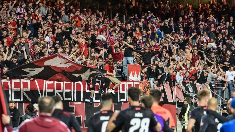 30 April 2018, Germany, Nuremberg: 2nd Bundesliga, 1. FC Nuremberg - Eintracht Braunschweig, Max-Morlock Stadium: Nuremberg's fans celebrate the 2-0 victory of their team. Photo: Nicolas Armer/dpa - IMPORTANT NOTICE: Due to the German Football League·s (DFL) accreditation regulations, publication and redistribution online and in online media is limited during the match to fifteen images per match