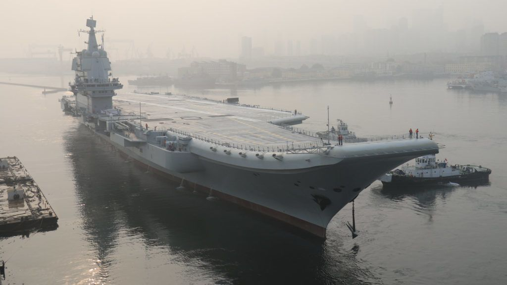 (180513) -- DALIAN, May 13, 2018 (Xinhua) -- China's first home-built aircraft carrier leaves Dalian in northeast China's Liaoning Province for sea trials on May 13, 2018. (Xinhua/Li Gang) (yxb)