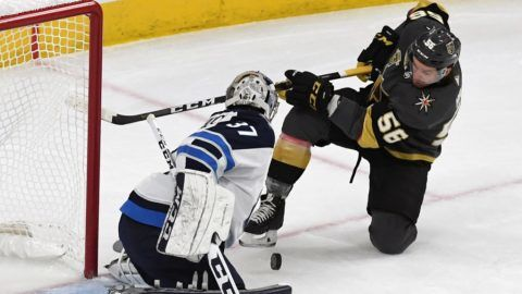 LAS VEGAS, NV - MAY 18: Connor Hellebuyck #37 of the Winnipeg Jets blocks a shot by Erik Haula #56 of the Vegas Golden Knights in the first period of Game Four of the Western Conference Finals during the 2018 NHL Stanley Cup Playoffs at T-Mobile Arena on May 18, 2018 in Las Vegas, Nevada. The Golden Knights won 3-2.   Ethan Miller/Getty Images/AFP