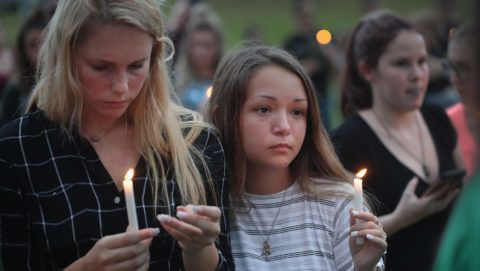 LEAGUE CITY , TX - MAY 20: Residents attend a prayer vigil to remember the victims from the Santa Fe High School shooting at Walter Hall Park on May 20, 2018 in League City, Texas. Last Friday, 17-year-old student Dimitrios Pagourtzis entered the school with a shotgun and a pistol and opened fire, killing 10 people.   Scott Olson/Getty Images/AFP