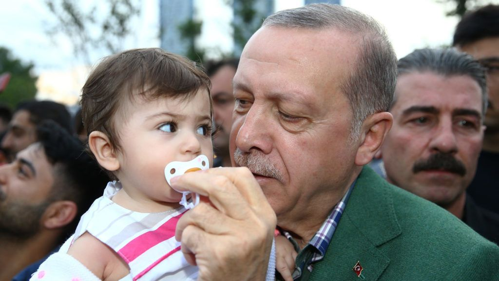 ISTANBUL, TURKEY - MAY 26: Turkish President Recep Tayyip Erdogan takes care of a baby as he meets people waiting for iftar (fast-breaking) dinner at Istanbul's Zeytinburnu district ahead of his meeting with police officials in Istanbul, Turkey on May 26, 2018.  Kayhan Ozer / Anadolu Agency