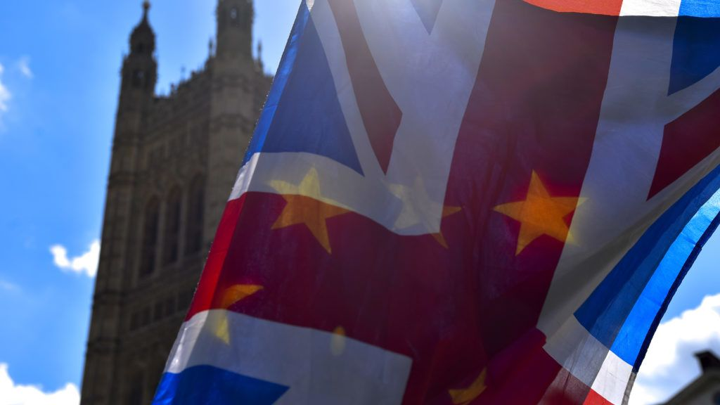 An anti-Brexit demonstrator waves a half Union and half EU flag outside the Parliament, London on May 1, 2018. Prime minister Theresa May says the government will be 'robust' in its response to a House of Lords defeat which potentially gives Parliament a decisive say on Brexit.  (Photo by Alberto Pezzali/NurPhoto)