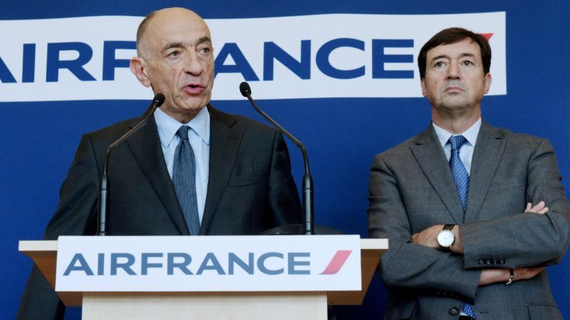 Air France-KLM's Chairman and Chief Executive Officer Jean-Marc Janaillac (L) speaks next to Air France's Chief Executive Officer Franck Terner (R) stand during a press conference in Paris on April 20, 2018 as Air France staff went on strike on April 18 for a ninth day since February aimed at securing higher pay. / AFP PHOTO / ERIC PIERMONT