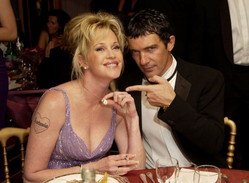 """Melanie Griffith and Antonio Banderas during Cannes 2002 - """"Femme Fatale"""" Dinner at Le Dome, Carlton Hotel in Cannes, France. (Photo by J. Vespa/WireImage)"""