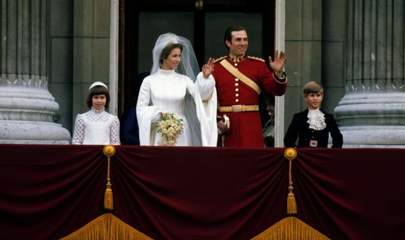LONDON - NOVEMBER 14: Princess Anne, Princess Royal and Mark Phillips wave from the balcony of Buckingham Palace following their wedding with Prince Edward, Earl of Wessex (R) on November 14, 1973 in London, England.  (Photo by Anwar Hussein/Getty Images)