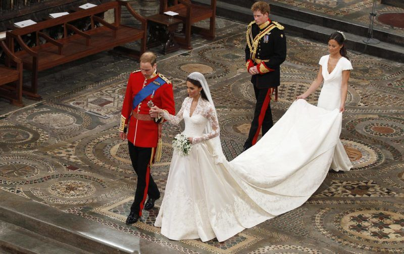 LONDON, ENGLAND - APRIL 29: Prince William takes the hand of his bride Catherine Middleton, now to be known as Catherine, Duchess of Cambridge, followed by Prince Harry and Pippa Middleton as they walk down the aisle inside Westminster Abbey on April 29, 2011 in London, England.  The marriage of Prince William, the second in line to the British throne, to Catherine Middleton is being held in London today. The marriage of the second in line to the British throne is to be led by the Archbishop of Canterbury and will be attended by 1900 guests, including foreign Royal family members and heads of state. Thousands of well-wishers from around the world have also flocked to London to witness the spectacle and pageantry of the Royal Wedding.  (Photo by  Kirsty Wigglesworth - WPA Pool/Getty Images)