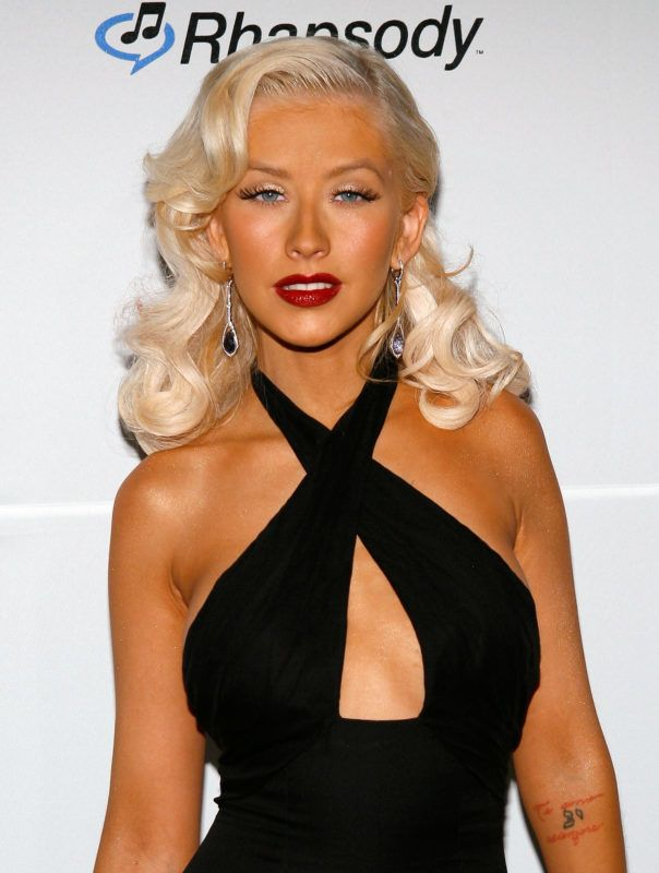 BEVERLY HILLS, CA - FEBRUARY 10:  Singer Christina Aguilera arrives at the Clive Davis pre-Grammy party held at the Beverly Hilton on February 10, 2007 in Beverly Hills, California.  (Photo by Vince Bucci/Getty Images)