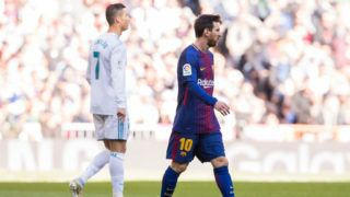 MADRID, SPAIN - DECEMBER 23: Lionel Andres Messi (R) of FC Barcelona and Cristiano Ronaldo of Real Madrid look on during the La Liga 2017-18 match between Real Madrid and FC Barcelona at Santiago Bernabeu Stadium on December 23 2017 in Madrid, Spain. (Photo by Power Sport Images/Getty Images)