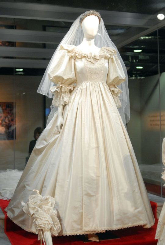 """PHILADELPHIA - OCTOBER 1: Princess Diana's wedding gown is displayed at a preview of the traveling """"Diana: A Celebration"""" exhibit at the National Constitution Center on October 1, 2009 in Philadelphia, Pennsylvania. The exhibit, not shown in the U.S. since 2007, opens tomorrow and continues through December 31.  (Photo by William Thomas Cain/Getty Images)"""