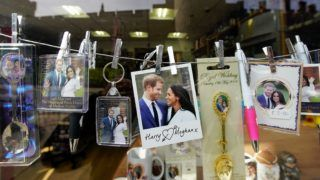 WINDSOR, ENGLAND - MAY 03:  Souvenirs featuring Britain's Prince Harry and his fiance US actress Meghan Markle are displayed in a gift shop on May 3, 2018 in Windsor, England.  St George's Chapel at Windsor Castle will host the wedding of Britain's Prince Harry and US actress Meghan Markle on May 19. The town, which gives its name to the Royal Family, is ready for the event and the expected tens of thousands of royalists.  (Photo by Christopher Furlong/Getty Images)