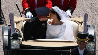 WINDSOR, ENGLAND - MAY 19: Prince Harry, Duke of Sussex and the Duchess of Sussex kiss in the Ascot Landau Carriage as their carriage procession rides along the Long Walk, on May 19, 2018 after their wedding ceremony.  (Photo by Yui Mok - WPA Pool/Getty Images)
