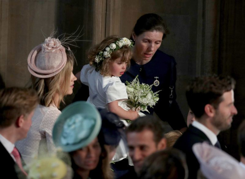 WINDSOR, UNITED KINGDOM - MAY 19: Royal Nanny Maria Teresa Turrion Borrallo comforts bridesmaid Zalie Warren inside the entrance to the chapel before the wedding of Prince Harry to Meghan Markle in St George's Chapel at Windsor Castle on May 19, 2018 in Windsor, England. (Photo by Owen Humphreys - WPA Pool/Getty Images)