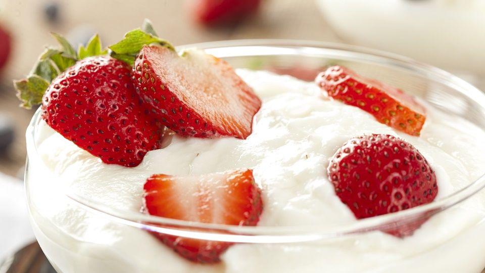 15115820 - fresh organic greek yogurt with strawberries on a background