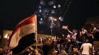 Bagdad, 2018. május 14.Muktada asz-Szadr radikális síita hitszónok támogatói ünnepelnek a bagdadi Tahrír téren a 2018. május 14-ére virradó éjjel. Az előző napi iraki parlamenti választások részleges eredménye szerint az asz-Szadr vezette asz-Szajrún pártszövetség vezet. (MTI/AP/Hadi Mizban)