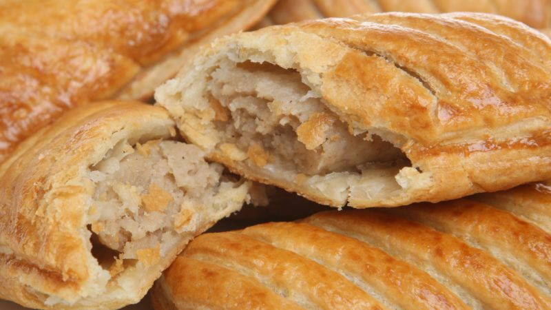 Close-up of freshly baked sausage rolls.
